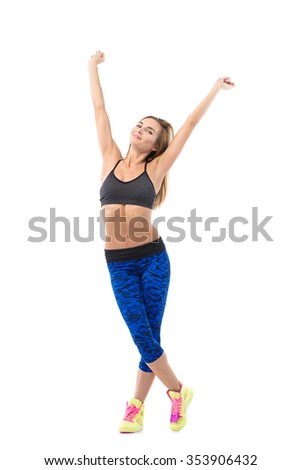 Young positive healthy woman in bright stylish fitness wear