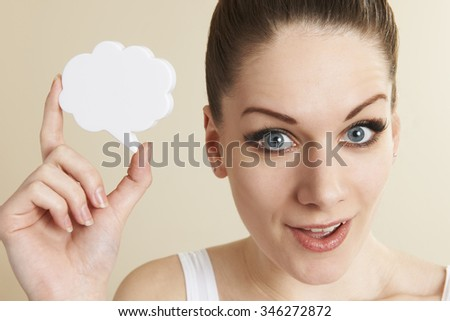 Young Positive Woman Holding Speech Bubble