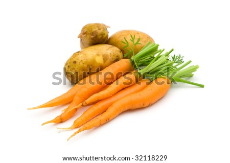 young potatoes and carrots on white background - stock photo