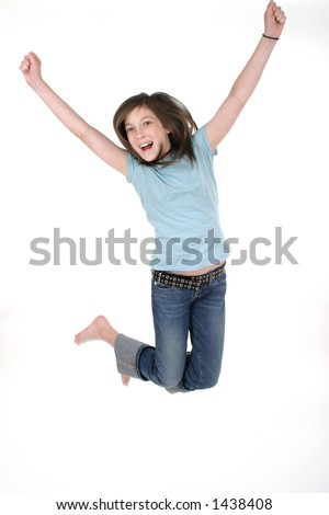 Young pre teen or tween girl jumping up in the air with arms outstretched.  Shot on white. - stock photo