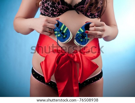 young pregnant woman - stock photo