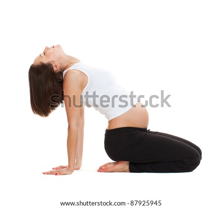 young pregnant woman doing gymnastic. isolated on white background - stock photo