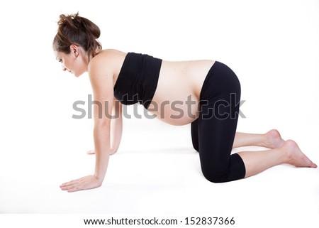Young pregnant woman practises yoga asana - stock photo