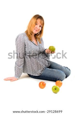 young pregnant woman with apples on white - stock photo