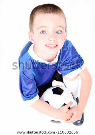 Young preschool boy with a soccer ball on white background - stock photo