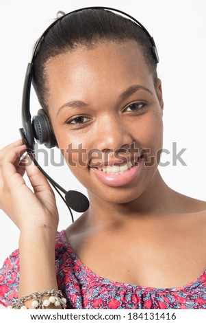 Young Pretty Black Call Cetre agent talking to a client - stock photo