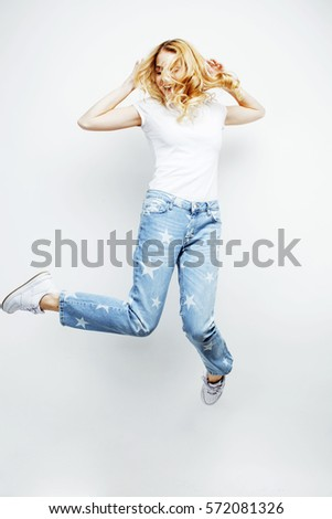 young pretty blond girl jumping isolated on white background, lifestyle flying people concept