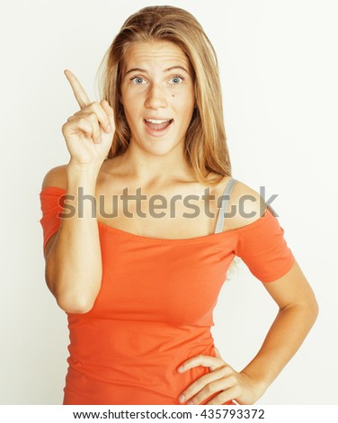 young pretty blond woman thinking showing to copyspace isolated on white close up emotional - stock photo