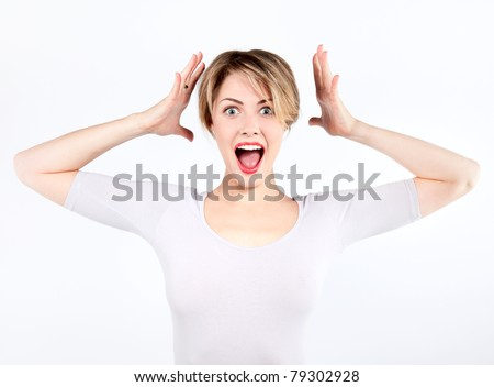 Young pretty blonde girl screams and with shocked expression - stock photo
