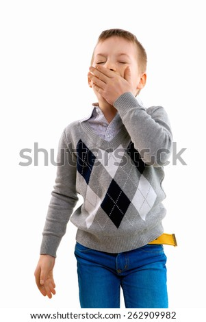 Young pretty boy posing at studio. boy yawns. Isolated on a white background - stock photo