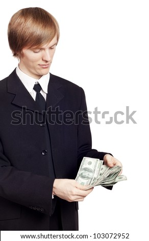 Young pretty businessman holding cash - stock photo