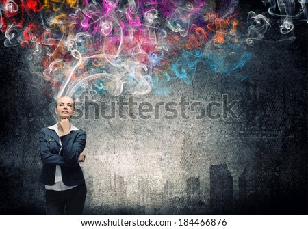 Young pretty businesswoman thinking over the ideas. Creativity concept - stock photo