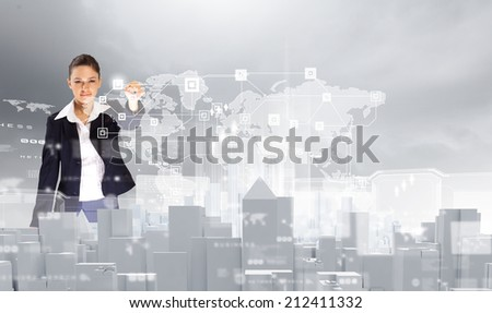 Young pretty businesswoman touching icon of media screen