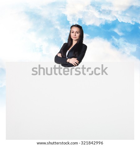 Young pretty businesswoman with white blank banner - stock photo