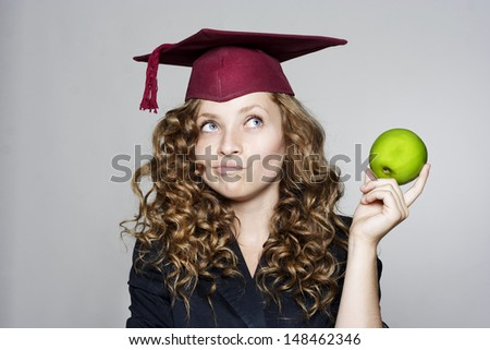 Young pretty caucasian student with an apple