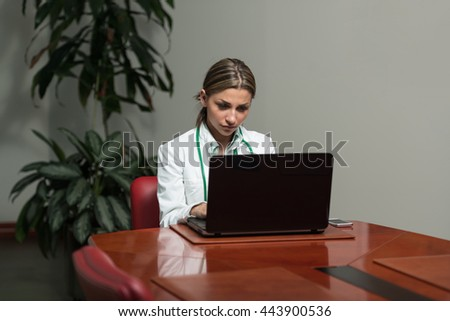 Young Pretty Female Doctor With Notebook In The Office - Successful Woman Doc At Work