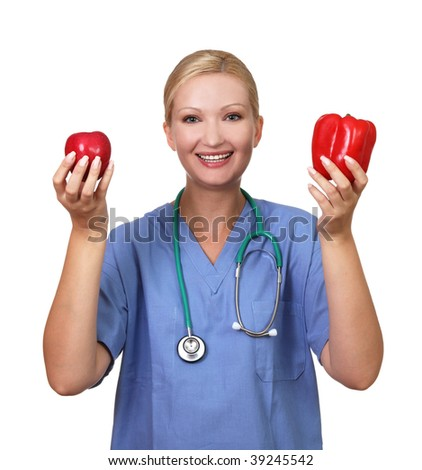 Young pretty female holds red apple and pepper,isolated on white - stock photo