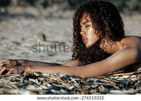 young pretty girl asian face curly hairstyle at beach, vacation tann - stock photo