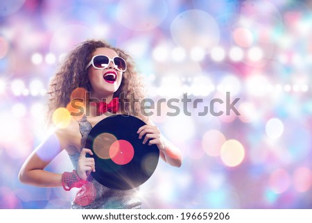 Young pretty girl dj at disco party holding vinyl - stock photo