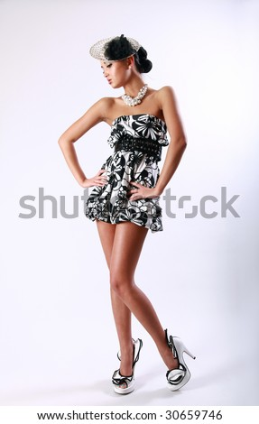Young pretty girl in a vintage black and white dress