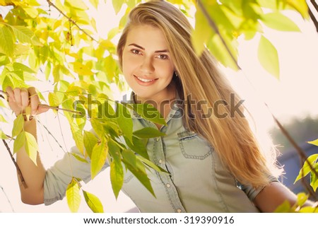 Young pretty girl in autumn park - stock photo