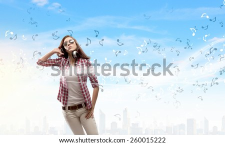 Young pretty girl in casual wearing headphones - stock photo