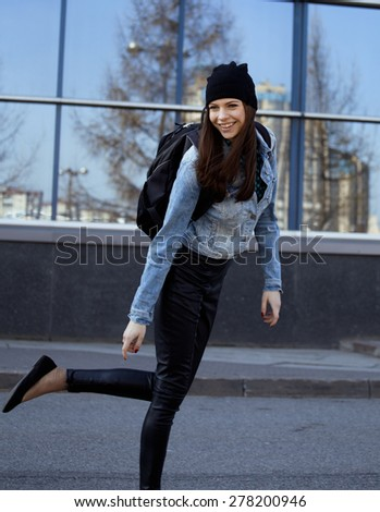 young pretty girl near business building walking, student in america having fun - stock photo