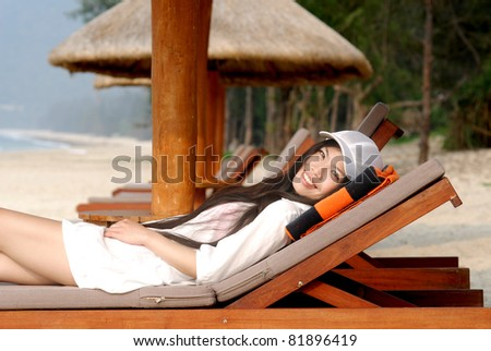 young pretty girl on vacations at beach - stock photo