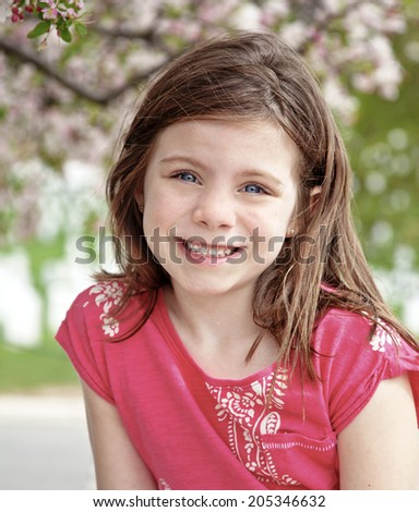 Young pretty girl portrait surrounded by blossoms - stock photo