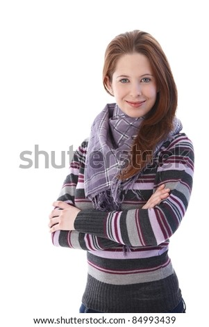 Young pretty girl standing arms crossed, smiling.? - stock photo