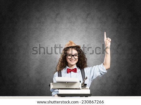Young pretty girl writer using typing machine - stock photo