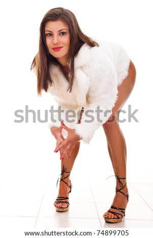 young pretty nude girl in white fur coat and high-heeled shoes - stock photo