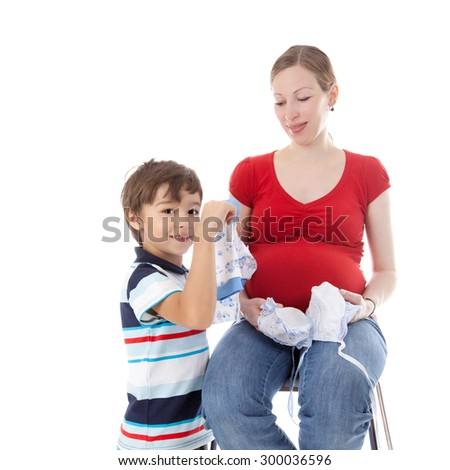 young pretty pregnant mother with the child and baby clothing