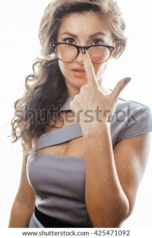 young pretty real brunette woman secretary in sexy dress wearing glasses isolated on white background pointing gesturing emotional cheerful lady - stock photo