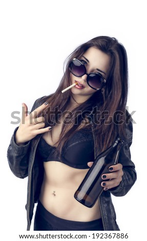 Young Pretty Rocker Woman holding a Bottle on White Background - stock photo