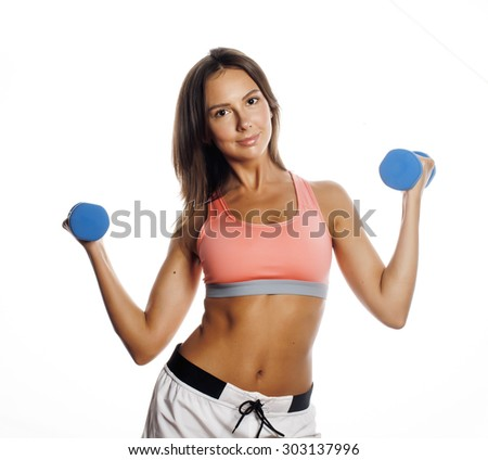 young pretty slim woman with dumbbell isolated cheerful smiling