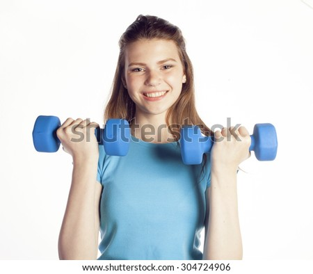 young pretty slim woman with dumbbell isolated cheerful smiling, girl next door - stock photo