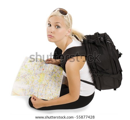 young pretty student girl in vacation with rucksack sitting and looking in camera - stock photo