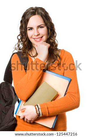 Young pretty student girl with backpack and exercise books.