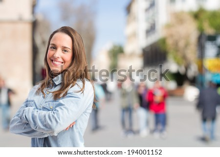young pretty student smiling - stock photo