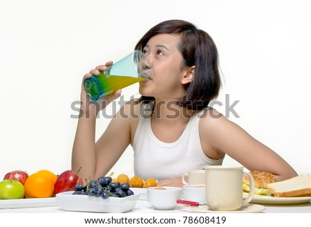 Young pretty teenager drink orange juice for morning breakfast, isolated background - stock photo
