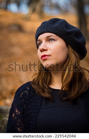 Young pretty woman at the autumn park. - stock photo