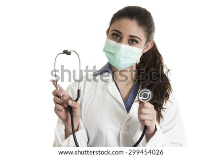 Young pretty woman doctor wearing a mask and holding stethoscope with both hands isolated on white - stock photo