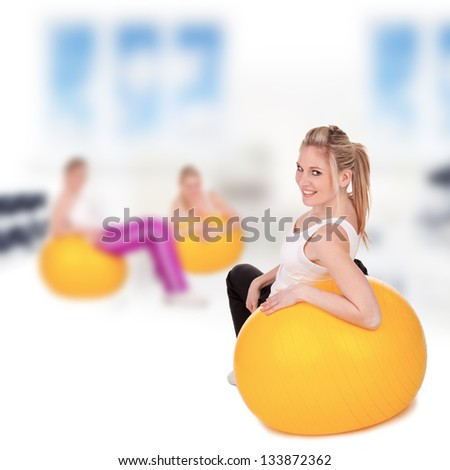 Young pretty woman doing body training indoor - stock photo
