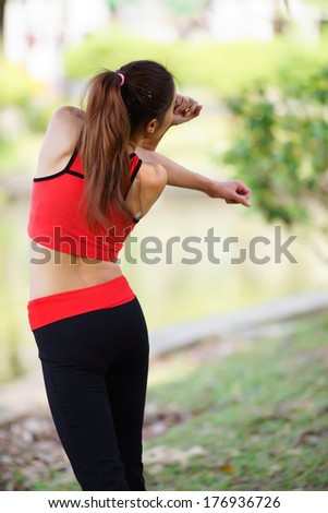 Young pretty woman doing yoga exercises in the park - stock photo