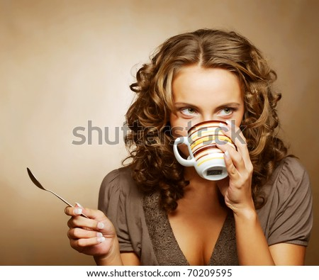 young pretty woman drinking coffee
