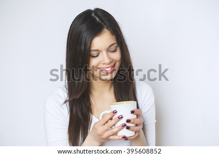 young pretty woman drinking coffee or tea . Relaxing girl . Woman drinking coffee in the morning at home lifestyle.
