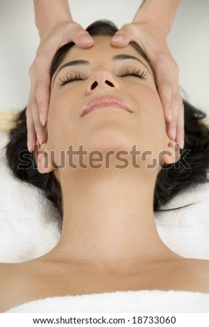 young pretty woman getting head massage - stock photo
