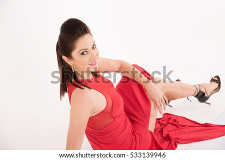 young pretty woman happy smiling and sitting on the floor