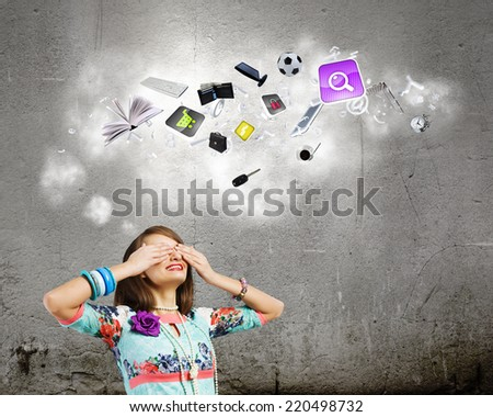 Young pretty woman hiding eyes behind hands - stock photo
